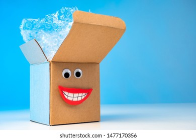Emoji box. Packing of goods. Cardboard boxes. Delivery of purchases home. Positive emotions from shopping. Box with bubble wrap. Delivery service. boxes for moving. Cardboard packaging materials