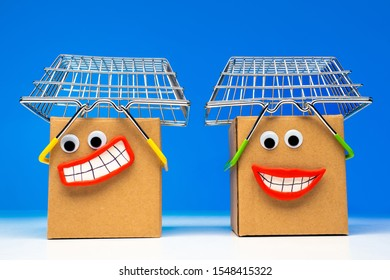 Emoji. Metaphor - Shopaholics.Online shopping. Shopping at an online auction. Emoji box. Concept - Point of delivery of goods online store. Cardboard boxes are smiling. Shopping baskets.Happy shoppers