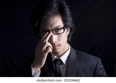 Emotion of Businessman: Serious on Isolated Black Background