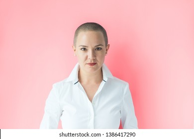 Emotion expectation joy. Portrait confident beautiful happy young bald woman in white shirt on colored background wall. Human emotions facial expression concept
