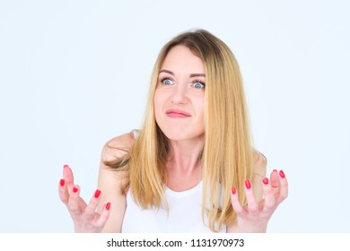 emotion face. angry mad cross enraged woman. young beautiful blond girl portrait on white background.
