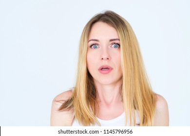 emotion face. astounded overwhelmed shocked surprised amazed woman. young beautiful blond girl portrait on white background.
