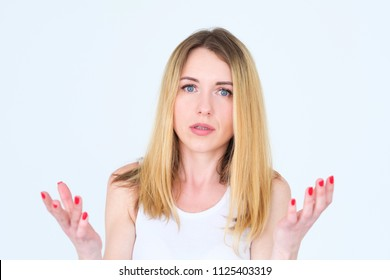 emotion face. puzzled perplexed shocked surprised woman. hands at loss. young beautiful blond girl portrait on white background.