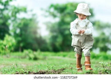 Emotion image to Morning relaxation and cozy with Happiness Asian kid portrait be walking on a nature Background. Used to Advertise or Website Promote.
