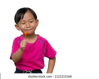 Emotion stance of Cute asian little boy wearing pink t-shirt. A red lollipop in hand. He was very happy to be eating a red lollipop, Action isolate on white background