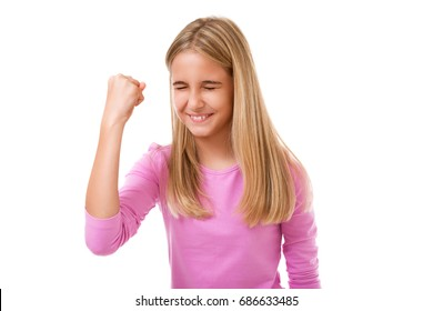 emotion, success, gesture and people concept - young teenage girl celebrating victory over white background