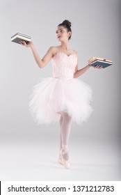 Emotion work is dance.Happy business,education  woman in ballet dance style.stand on floor,hand hold colorful thick book.