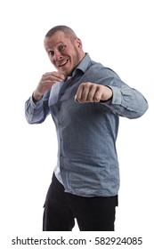 emotional actor man in a gray shirt posing and gesturing on a white background in studio