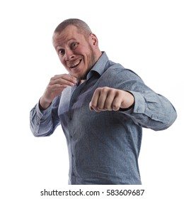 emotional actor man in a gray shirt boxing on a white background in studio