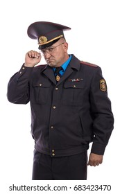 Emotional adult male actor as policeman posing against white background in studio On a jacket with yellow letters it is written: Militia (Police)