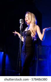 Emotional attractive singer. Scream, shout