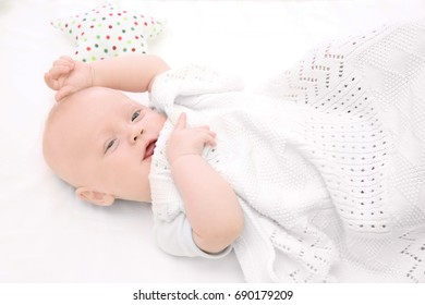 Emotional baby lying in cradle. Insomnia and sleep disorders concept