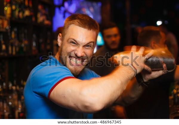 Emotional bartender makes a cocktail shaker