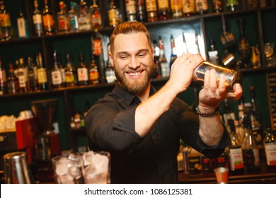 Emotional bartender working on making a cocktail