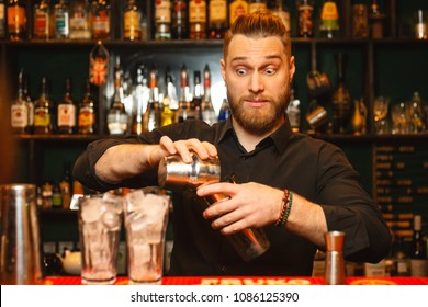 Emotional bartender working on making a cocktail