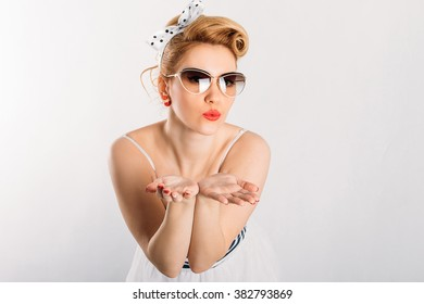Emotional beautiful girl in pin-up style poses
