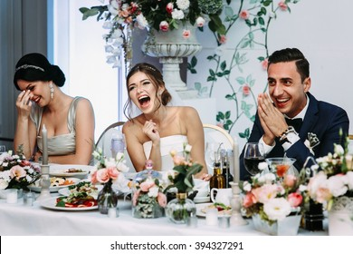 Emotional beautiful newlywed couple smiling at wedding reception