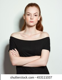 Emotional beauty portraits red-haired girl. On a neutral background.