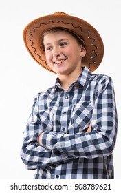Emotional blond boy plaid shirt and cowboy hat on a white background