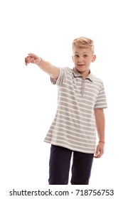 Emotional blond boy in striped sport shirt posing on white background