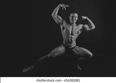 Emotional bodybuilder on black