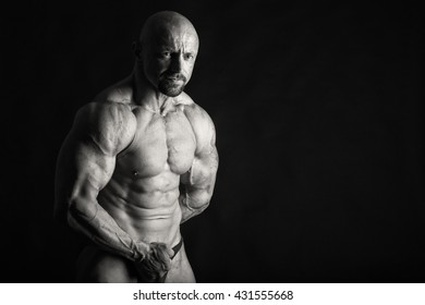 Emotional bodybuilder on black