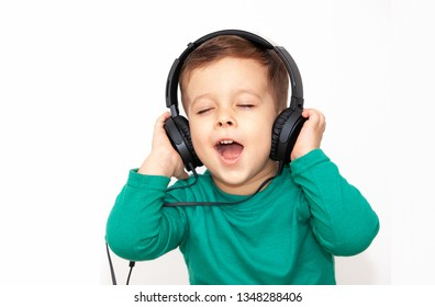 emotional boy in headphones on a light background