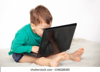 emotional boy with laptop on a light background