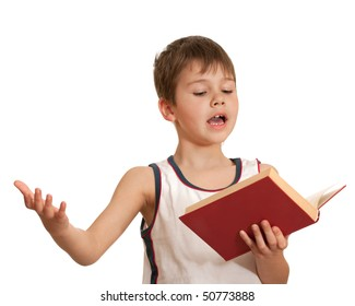 An emotional boy is reading very interesting book; isolated on the white background