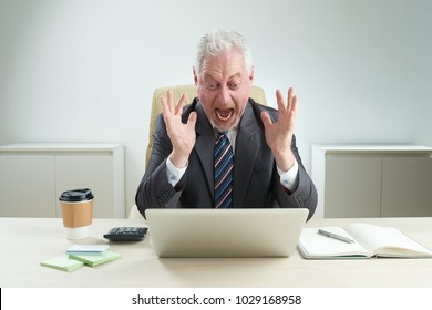 Emotional businessman shocked with news he is reading online