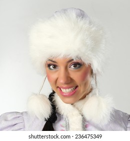 Emotional and cheerful Santa Girl in white and blue outfit. Girl in traditional ethnic dress