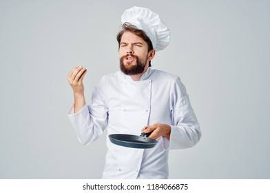 emotional chef with a frying pan in his hand