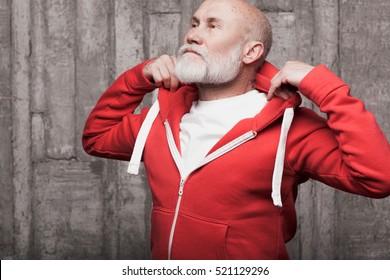 emotional closeup of Santa like man face in sportswear in studio