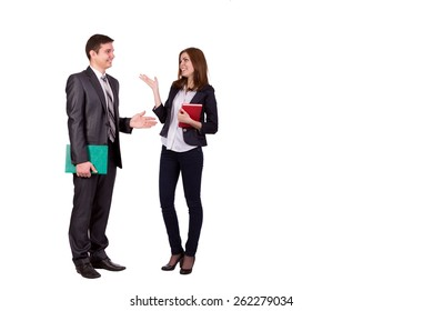 Emotional conversation. Young male and female, officially dressed, discussing and hand gesturing. Full body portrait on white background.