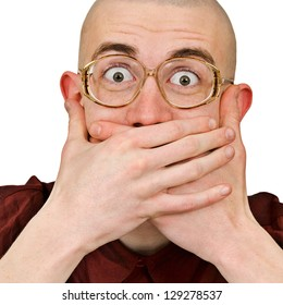 Emotional excited man in eye glasses keep his mouth closed by his hands isolated on white background