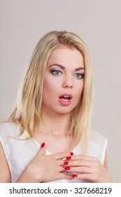 Emotional facial expression wide eyed woman surprised girl open mouth .