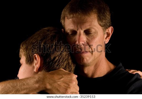 Emotional family hug, father crying