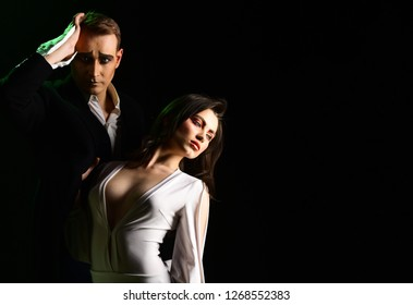An emotional feeling of love. Theatre actors miming through body motions. Couple in love with mime makeup. Mime man and woman act in romantic scene. Couple of mime artists perform romance, copy space.