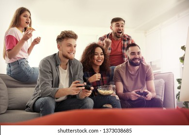 Emotional friends playing video games at home