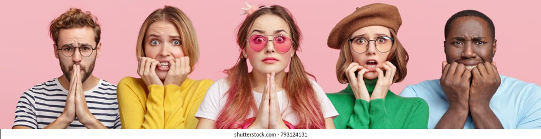 Emotional group of people being very nervous, bite nails as wait for announcing important results and pray for something, pose against pink background. Composition of mixed race adults indoor