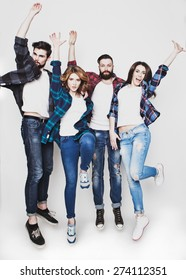 emotional, happiness and people concept: Two happy couples in casual clothing jumping in the air rejoicing with their arms raised isolated on white.Special Fashionable toning photos.