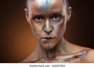 emotional hot girl with creative make up and body art.