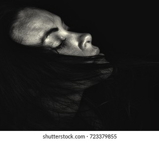 Emotional Image of a Beautiful Woman in Black and White