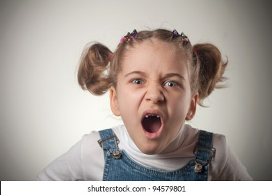 Emotional image of a little girl screaming