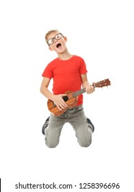 Emotional little boy playing guitar isolated on white