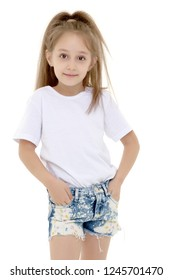 Emotional little girl in a clean white T-shirt. The concept can be used to advertise goods and services, whose logo can be printed on the surface of the shirt. Isolated on white background