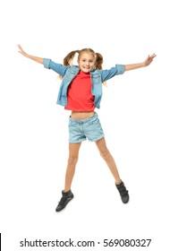 Emotional little girl jumping on white background