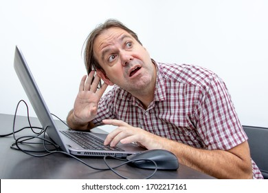 The emotional man in the office hearing the sound in a computer.