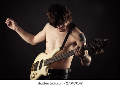 emotional man playing bass guitar