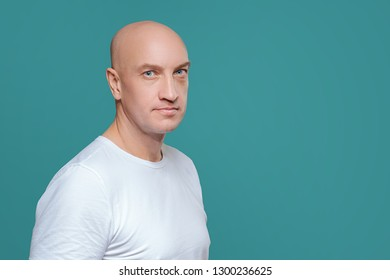 emotional man in white t-shirt with angry facial expression on background, isolation